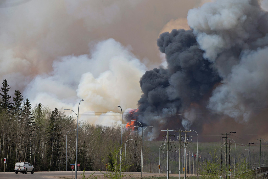 . A wildfire rages through Fort McMurray, Alberta on Wednesday May 4, 2016. The raging wildfire emptied Canada\'s main oil sands city, destroying entire neighborhoods of Fort McMurray, where officials warned Wednesday that all efforts to suppress the fire have failed.  (Jason Franson /The Canadian Press via AP)