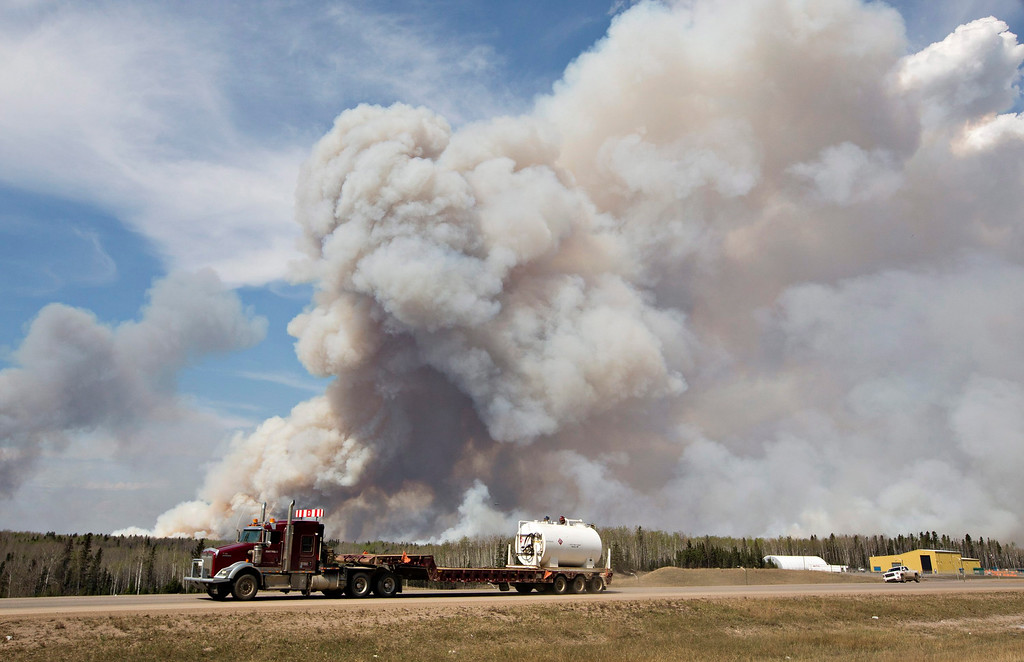 . A wildfire rages through Fort McMurray, Alberta, on Wednesday, May 4, 2016. The raging wildfire emptied Canada\'s main oil sands city, destroying entire neighborhoods of Fort McMurray, where officials warned Wednesday that all efforts to suppress the fire have failed.  (Jason Franson /The Canadian Press via AP)