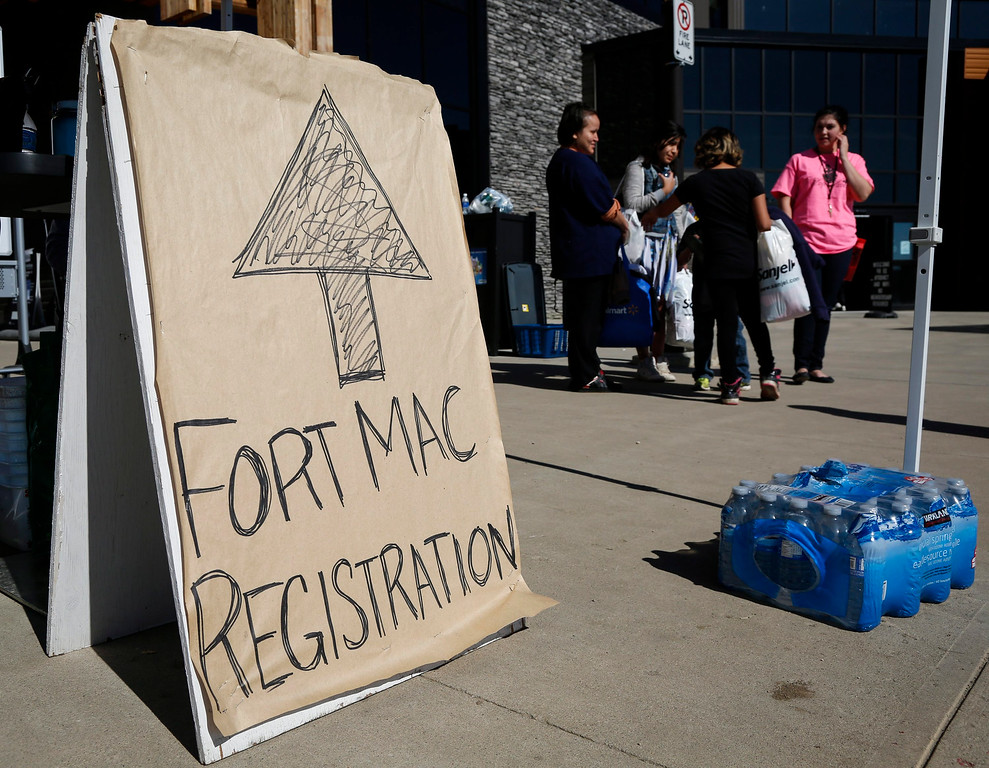 . Evacuees from the Fort McMurray wildfires continue to arrive at the evacuation center in Lac la Biche, Alberta, Friday, May 6, 2016. More than 80,000 people have left Fort McMurray, in the heart of Canada\'s oil sands, as a wildfire that has devastated the area exploded in size. (Jeff McIntosh/The Canadian Press via AP)