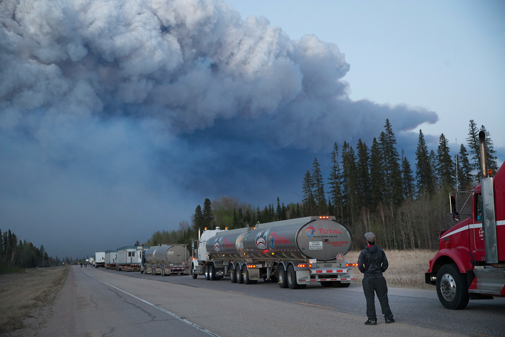 . Drivers wait for clearance to take firefighting supplies into town on May 05, 2016 outside of Fort McMurray, Alberta. Wildfires, which are still burning out of control, have forced the evacuation of more than 80,000 residents from the town.   (Photo by Scott Olson/Getty Images)