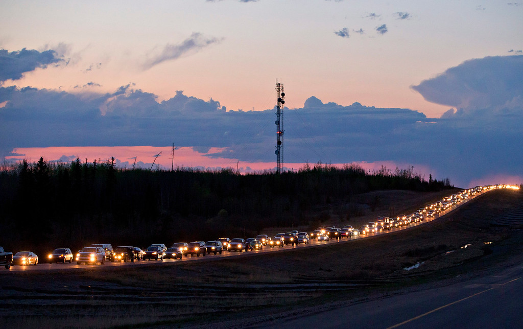 . Traffic lines the highway as residents leave Fort McMurray, Alberta, Canada, on Tuesday May 3, 2016.  More than 80,000 residents were ordered to flee as a wildfire moved into the city, destroying whole neighborhoods.   (Jason Franson/The Canadian Press via AP)