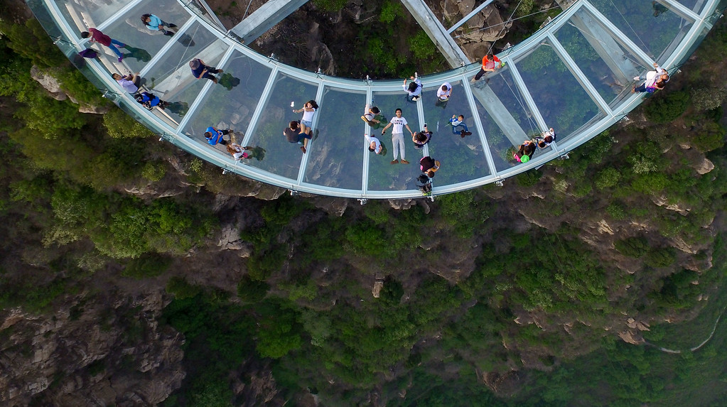 . This photo taken on April 30, 2016 shows a glass sightseeing platform in Shilinxia scenic spot in Pinggu District of Beijing.  The sightseeing platform, which hangs 32.8 meters out from the cliff, is claimed to be the largest glass sightseeing platform in the world. / AFP PHOTO / STR / AFP/Getty Images