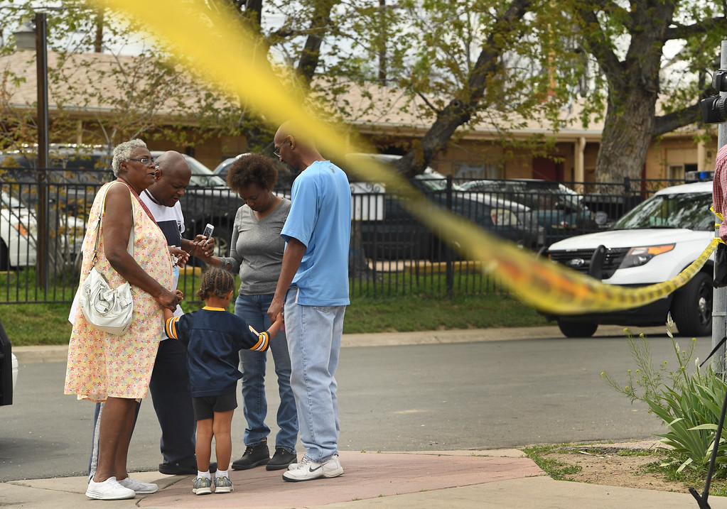 . DENVER, CO - MAY 9:  Claudine McCullough, left, and her grandson Jaden Mitchell, 3, take part in a prayer circle for the people in the neighborhood during an officer involved shooting investigation at Colfax ave between Wabash and Verbena streets on May 9, 2016 in Denver, Colorado. One person was transported to an area hospital in critical condition. (Photo by Helen H. Richardson/The Denver Post)