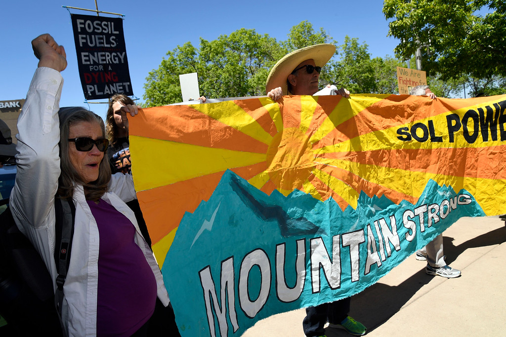 . LAKEWOOD, CO - MAY 12: Hundreds of Colorado community, climate and fracking activists chant and block the entrance to the Holiday Inn to protest a Bureau of Land Management oil and gas lease auction May 12, 2016 in Lakewood. The group rallied to disrupt the auction which was being held inside the hotel. The groups plan was to demand that public lands be no longer drilled, mined, or fracked. The protest was part of a global week of action focused on citizen action to keep fossil fuels in the ground and promote clean renewable energy, and comes days after the Colorado Supreme Court denied local authority to regulate fracking. (Photo By John Leyba/The Denver Post)