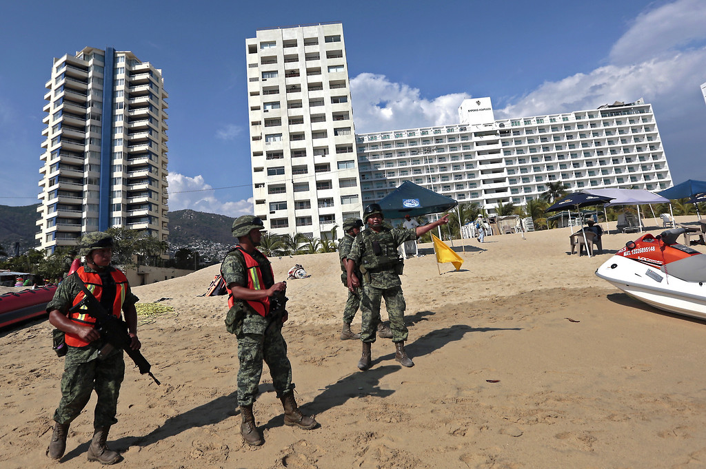 . Mexican soldiers patrol a beach at the Bay of Santa Lucia in Acapulco, Guerrero state, Mexico after an increase of violence in the tourist area of this sea resort, on March 4, 2016. The country endured 10 years of drug violence that has left 100,000 people dead or missing.    PEDRO PARDO/AFP/Getty Images