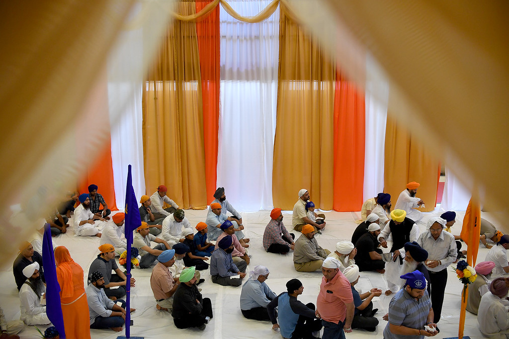 . DENVER, CO - MAY 22: Men pray during a Sikh religious observance at East High School on Sunday, May 22, 2016. This was Denver\'s first ever Sikh parade. The event was held to celebrate the culture of the growing Sikh population in the area. (Photo by AAron Ontiveroz/The Denver Post)