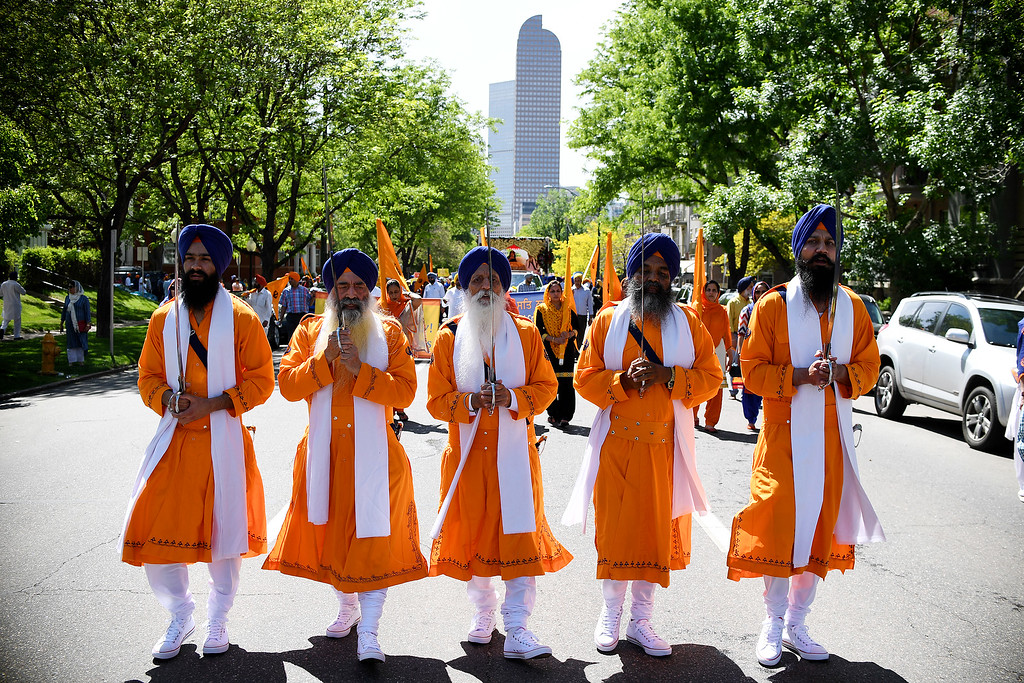 . DENVER, CO - MAY 22: A group of more than 1,000 Sikhs parade near 17th and Downing on Sunday, May 22, 2016. This was Denver\'s first ever Sikh parade. The event was held to celebrate the culture of the growing Sikh population in the area. (Photo by AAron Ontiveroz/The Denver Post)