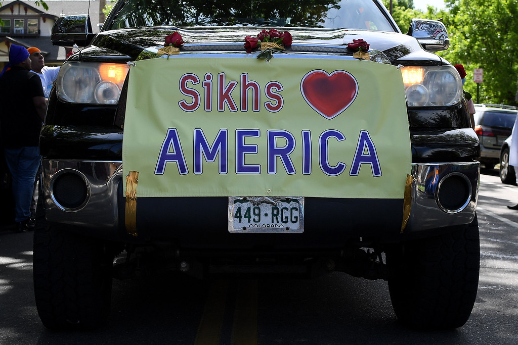 ". DENVER, CO - MAY 22: A sign proclaiming ""Sikhs (Heart) America\"" is affixed to the front of a truck during a Sikh Parade near East High School on Sunday, May 22, 2016. This was Denver\'s first ever Sikh parade. The event was held to celebrate the culture of the growing Sikh population in the area. (Photo by AAron Ontiveroz/The Denver Post)"