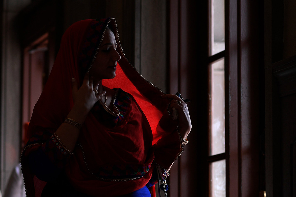 . DENVER, CO - MAY 22: Dimpy Singh adjusts her head scarf on Sunday, May 22, 2016. This was Denver\'s first ever Sikh parade. The event was held to celebrate the culture of the growing Sikh population in the area. (Photo by AAron Ontiveroz/The Denver Post)