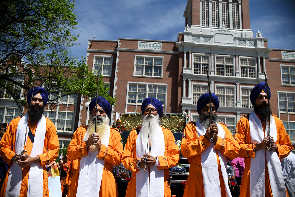 . DENVER, CO - MAY 22: Men stand in formation before leading the Guru Granth Sahib (Sikh scripture) during a Sikh parade at East High School on Sunday, May 22, 2016. This was Denver\'s first ever Sikh parade. The event was held to celebrate the culture of the growing Sikh population in the area. (Photo by AAron Ontiveroz/The Denver Post)