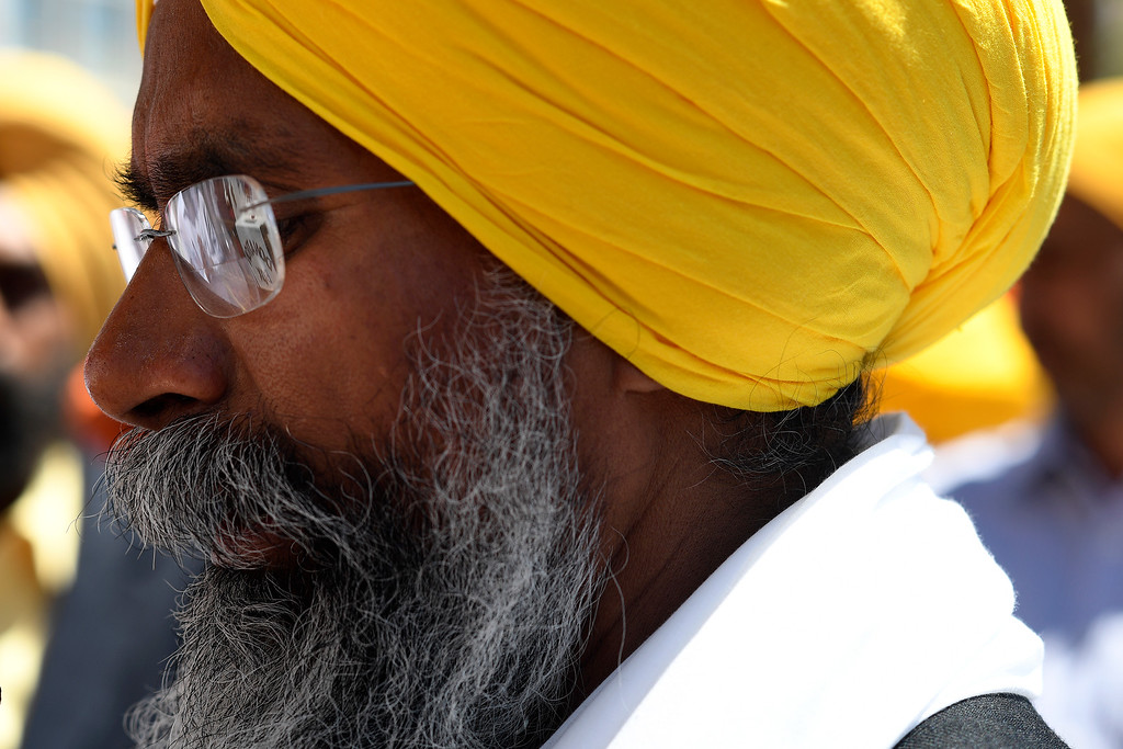 . DENVER, CO - MAY 22: Granti Stander Singh leads people in prayer before embarking on a parade walk on Sunday, May 22, 2016. This was Denver\'s first ever Sikh parade. The event was held to celebrate the culture of the growing Sikh population in the area. (Photo by AAron Ontiveroz/The Denver Post)