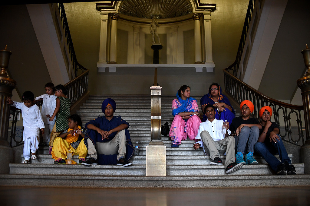 . DENVER, CO - MAY 22: Members of the Sikh community rest after a parade walk on Sunday, May 22, 2016. This was Denver\'s first ever Sikh parade. The event was held to celebrate the culture of the growing Sikh population in the area. (Photo by AAron Ontiveroz/The Denver Post)