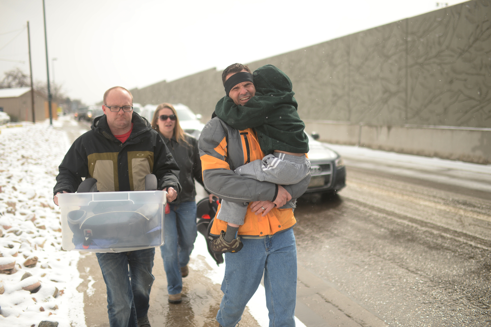 . DENVER MARCH 1: A family, they were in accident, get out from car accident site near North bound of I-25 Logan Exit.  Denver, Colorado. March 1. 2014. They did not identify their names. (Photo by Hyoung Chang/The Denver Post)