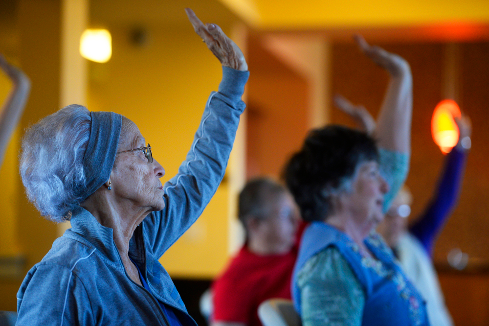 . WHEAT RIDGE, CO.- MARCH 20: Martha Williams, left, and other seniors, participate in a Tai Chi class at the Wheat Ridge Town Center Apartments, a new senior housing community, Thursday morning, March 20, 2014. The center offers a variety of on-site activities including coffee bar, Tai Chi, Wii bowling, fitness room, and gardening. (Photo By Andy Cross / The Denver Post)