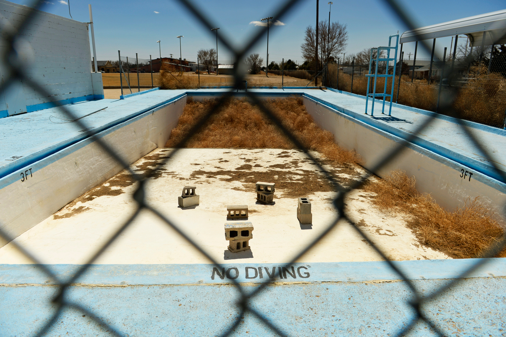 . EADS, CO - MARCH 31: Piled 10-feet-deep tumbleweeds collect in the deep end of the Eads swimming pool that is closed for the season, Monday, March 31, 2014. Years of drought in southeast Colorado is causing Russian Thistle to  (Photo by RJ Sangosti/The Denver Post)