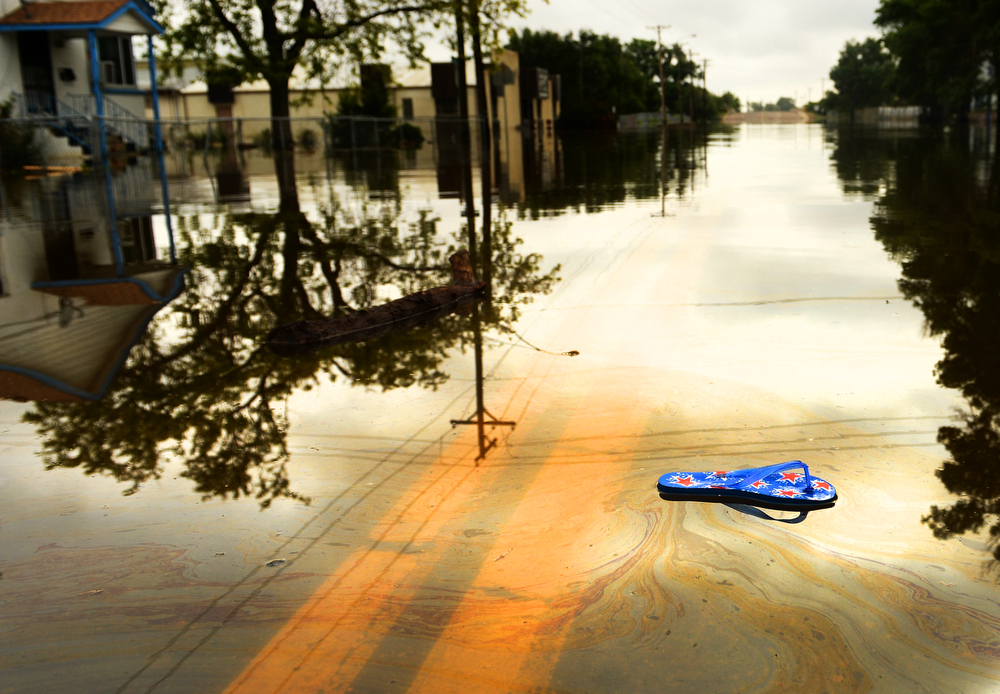 . A flip flop sandal floats along 5th Street in Greeley due to rising water along the Poudre River, June 4, 2014. A flood warning for the Poudre River near Greeley has been extended through Sunday. (Photo by RJ Sangosti/The Denver Post)