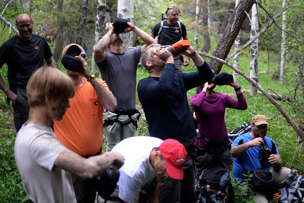 . WARD, CO - JUNE 10: Students drink the last of their water before learning about filtration in the wilderness. Bear Grylls survival school at Glacier View Ranch near Ward, Colorado on Tuesday, June 10, 2014. (Photo by AAron Ontiveroz/The Denver Post)
