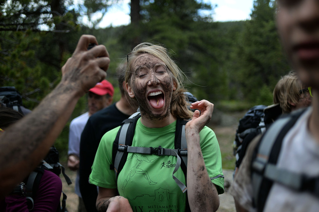 . WARD, CO - JUNE 10: Elizabeth Beem reacts to putting a grub in her mouth. Bear Grylls survival school at Glacier View Ranch near Ward, Colorado on Tuesday, June 10, 2014. (Photo by AAron Ontiveroz/The Denver Post)