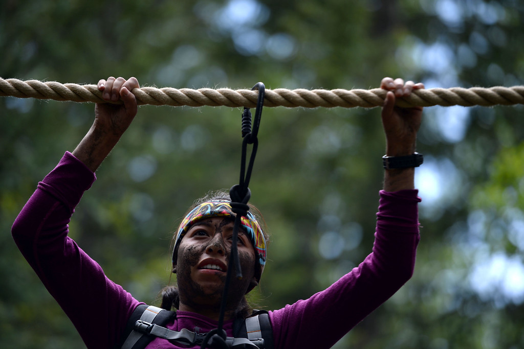 . WARD, CO - JUNE 10: Joanna Rivera works her way across a rope bridge. Bear Grylls survival school at Glacier View Ranch near Ward, Colorado on Tuesday, June 10, 2014. (Photo by AAron Ontiveroz/The Denver Post)