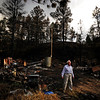 Gyorgy Vidacs looks through the remains of his burned home after he and other residents were let back into their properties on Rist Canyon Road on Thursday, June 28, 2012. AAron Ontiveroz, The Denver Post