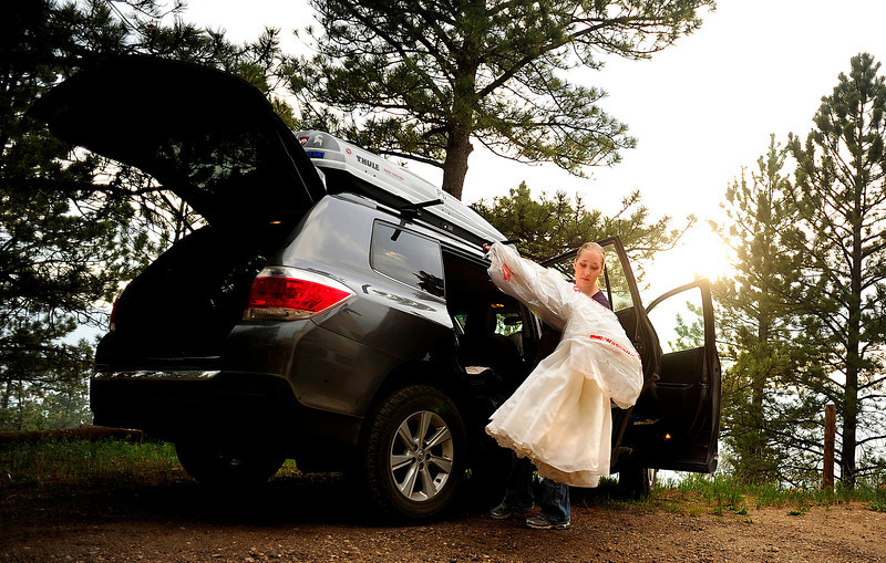 Rebecca DeMott packs her wedding dress as her parents' home in Glacier View Meadows was under pre-evacuation notice as the High Park fire burns on Stove Prairie Road and Highway 14 in Poudre Canyon west of Fort Collins on Tuesday, June 12, 2012. The fire has now burned more than 40,000 acres encompassing more than 65 square miles. AAron Ontiveroz, The Denver Post