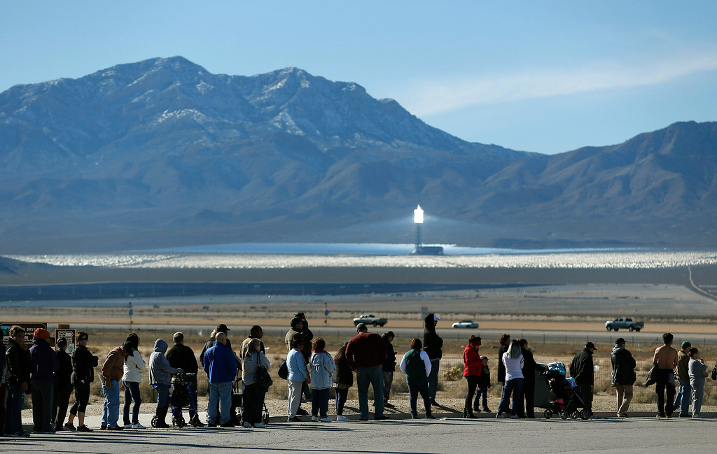 . Patrons line up to buy Powerball lottery tickets outside the Primm Valley Casino Resorts Lotto Store just inside the California border Tuesday, Jan. 12, 2016, near Primm, Nev. The Powerball jackpot has grown to over $1 billion dollars for the next drawing on Wednesday. (AP Photo/John Locher)