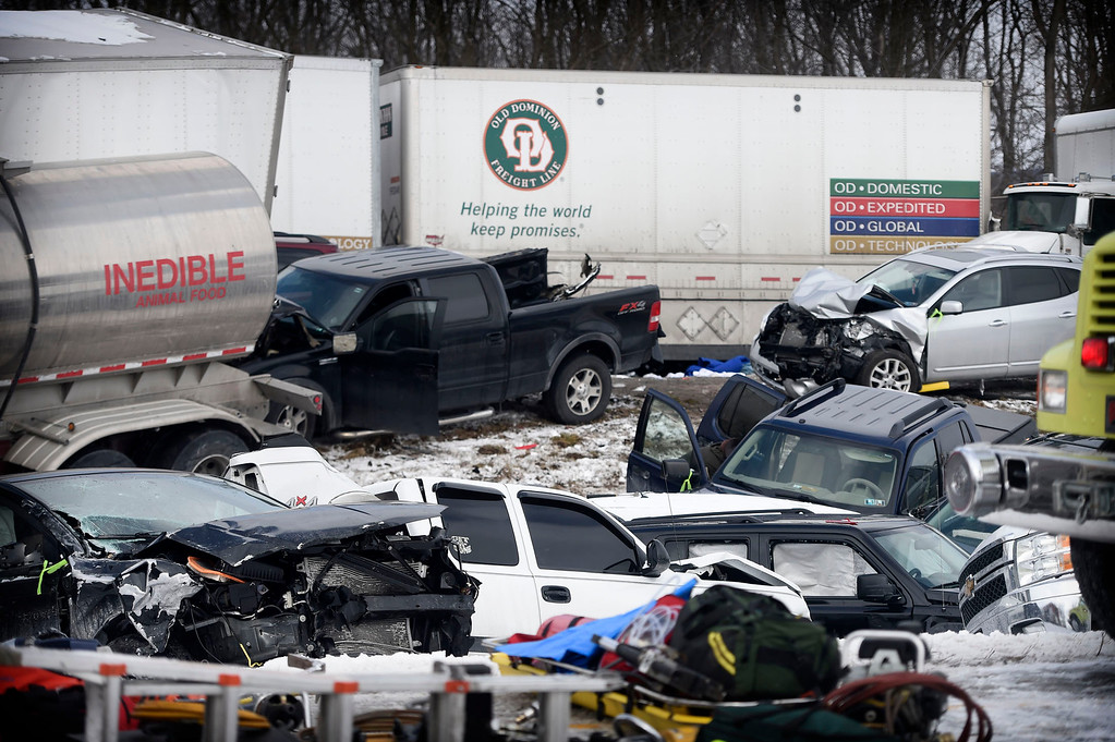 . Vehicles pile up after a fatal crash near Fredericksburg, Pa., Saturday, Feb. 13, 2016. The pileup left tractor-trailers, box trucks and cars tangled together across several lanes of traffic and into the snow-covered median. (Michael K. Dakota/Lebanon Daily News via AP)
