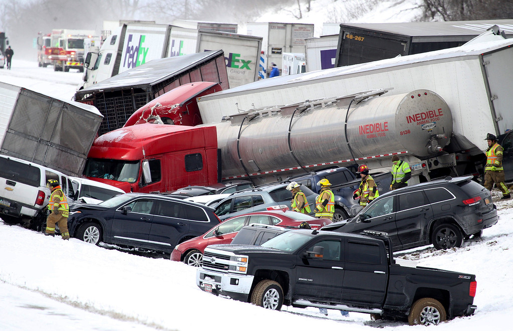 . Emergency personnel work at the scene of a crash near Fredericksburg, Pa., Saturday, Feb. 13, 2016. State police say a pileup has closed Interstate 78 in central Pennsylvania. (Daniel Zampogna/PennLive.com via AP)