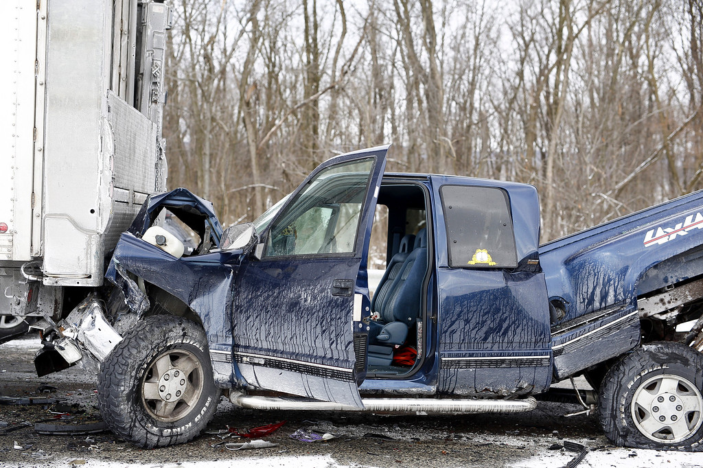 . A crushed vehicle remains on the scene after a fatal crash near Fredericksburg, Pa., Saturday, Feb. 13, 2016. State police say the pileup has closed Interstate 78 in central Pennsylvania. (Daniel Zampogna/PennLive.com via AP)