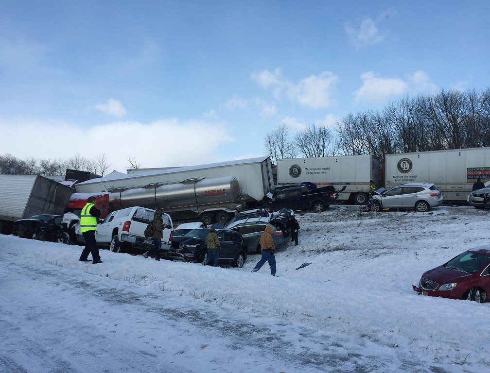 . Vehicles pile up at the site of a fatal crash near Fredericksburg, Pa., Saturday, Feb. 13, 2016. The pileup left tractor-trailers, box trucks and cars tangled together across several lanes of traffic and into the snow-covered median. (Cooper Leslie via AP)