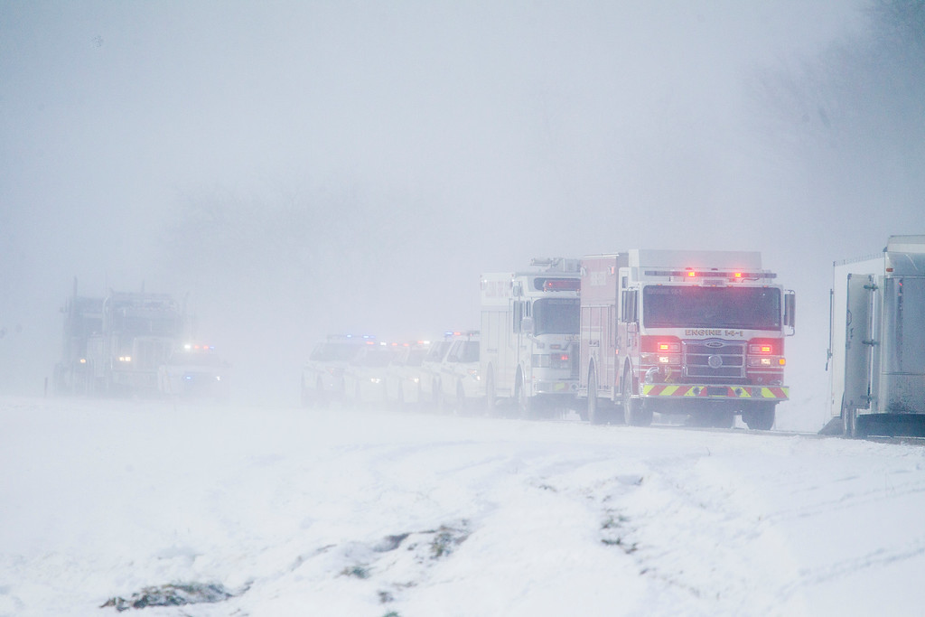 . Emergency vehicles line up at the site of a fatal crash near Fredericksburg, Pa., Saturday, Feb. 13, 2016. The pileup left tractor-trailers, box trucks and cars tangled together across several lanes of traffic and into the snow-covered median. (Daniel Zampogna/PennLive.com via AP)