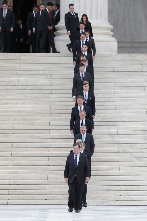 . One hundred and eighty law clerks line the stairs in front of the U.S. Supreme Court in anticipation of the arrival of Associate Justice Antonin Scalia\'s casket at the court building February 19, 2016 in Washington, DC. Justice Scalia will lie in repose in the Great Hall of the high court where visitors will pay their respects.  (Photo by Chip Somodevilla/Getty Images)