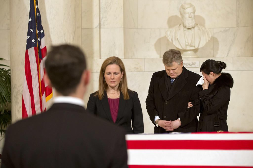 . A woman cries as friends and staff of the Supreme Court attend a private ceremony in the Great Hall of the Supreme Court where late Supreme Court Justice Antonin Scalia lies in repose on February 19, 2016 in Washington, DC. Justice Scalia will lie in repose in the Great Hall of the high court where visitors will pay their respects. (Photo by Jacquelyn Martin - Pool/Getty Images)