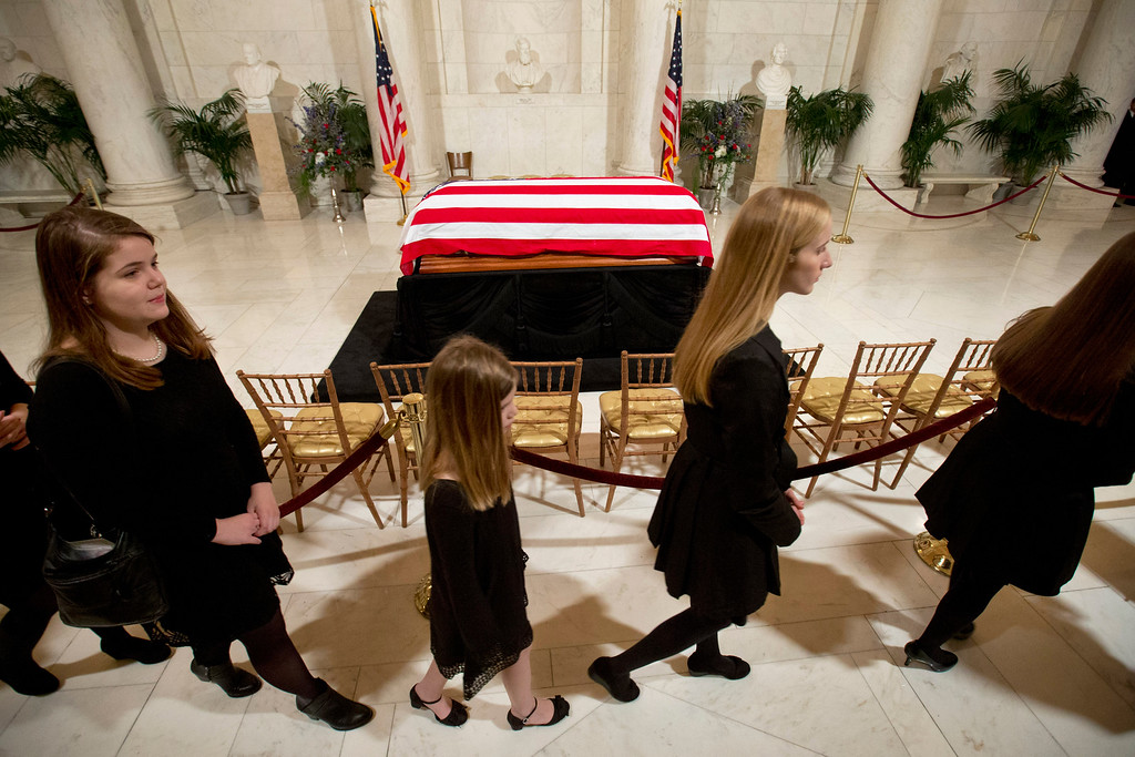 . Relatives pass the casket of Supreme Court Justice Antonin Scalia as they leave a private ceremony in the Great Hall of the Supreme Court in Washington, Friday, Feb. 19, 2016, where Scalia lies in repose. (AP Photo/Jacquelyn Martin, Pool)