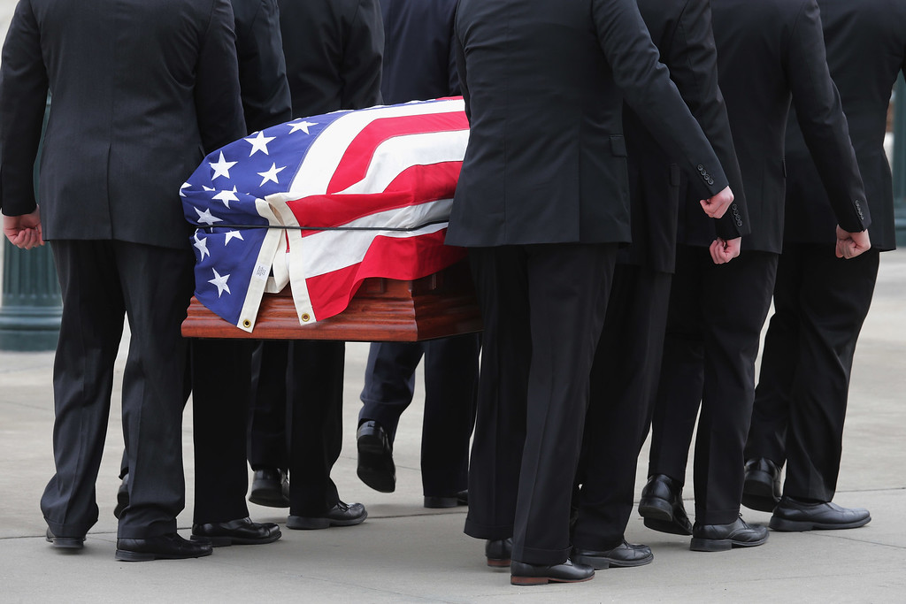 . U.S. Supreme Court Associate Justice Antonin Scalia\'s casket is carried by court police pallbearers into the court building February 19, 2016 in Washington, DC. Justice Scalia will lie in repose in the Great Hall of the high court where visitors will pay their respects.  (Photo by Chip Somodevilla/Getty Images)