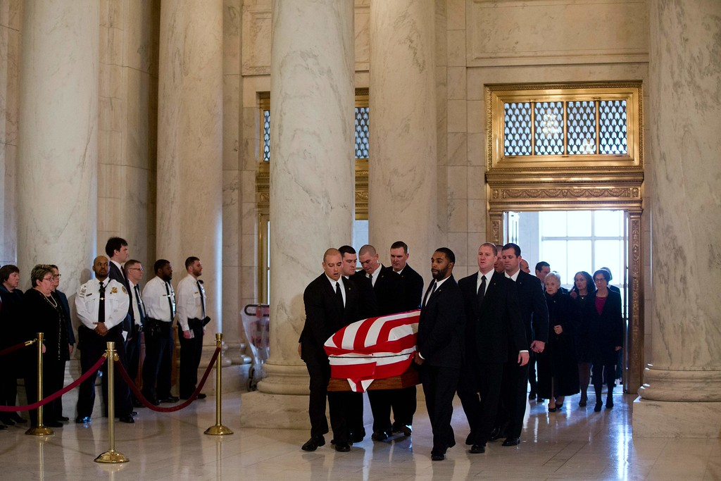 . The casket of late Supreme Court Justice Antonin Scalia is carried into the Great Hall of the US Supreme Court for a private ceremony in Washington on February 19, 2016.   / AFP / POOL / Jacquelyn  MARTIN/AFP/Getty Images