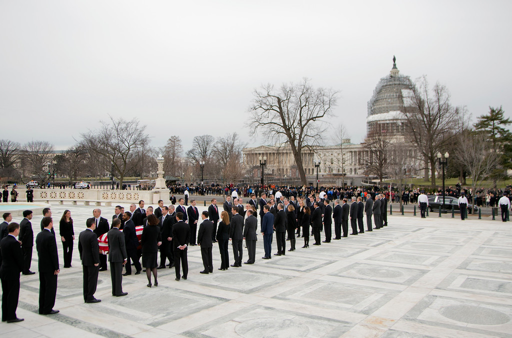 . The body of Justice Antonin Scalia is carried into the Supreme Court in Washington, Friday, Feb. 19, 2016. Thousands of mourners will pay their respects Friday for Justice Antonin Scalia as his casket rests in the Great Hall of the Supreme Court, where he spent nearly three decades as one of its most influential members.   (AP Photo/Manuel Balce Ceneta)