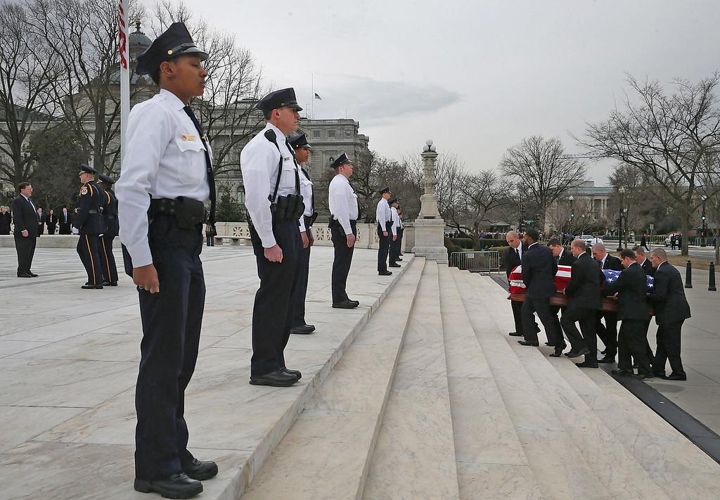 . Supreme Court police stand guard as the casket of Associate Justice Antonin Scalia is carried up the steps of the Supreme Court building, February 19, 2016 in Washington, DC. Justice Scalia will lie in repose in the Great Hall of the high Court where visitors can pay their respects.  (Photo by Mark Wilson/Getty Images)