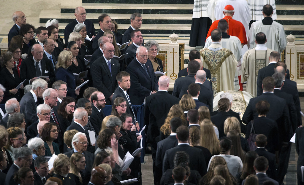 . Ushers guide the casket to the alter as people look on during the funeral Mass for Associate Justice Antonin Scalia at the Basilica of the National Shrine of the Immaculate Conception February 20, 2016 in Washington, DC.  Scalia, who died February 13 while on a hunting trip in Texas, layed in repose in the Great Hall of the Supreme Court on Friday and his funeral service will be at the basillica today.   (Photo by  Doug Mills-Pool/Getty Images)