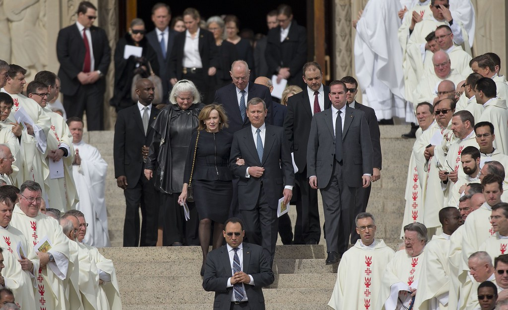 . Members of the Supreme Court, led by Chief Justice John G. Roberts, center, depart the funeral mass for the late Supreme Court Associate Justice Antonin Scalia, at the Basilica of the National Shrine of the Immaculate Conception in Washington, Saturday, Feb. 20, 2016. (AP Photo/Pablo Martinez Monsivais)