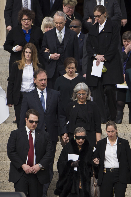 . Supreme Court Justices past and present walk down the steps of the Basilica of the National Shrine of the Immaculate Conception at the end of the funeral for late Supreme Court justice Antonin Scalia, February 20, 2016 in Washington, DC. At front row center is Justice Ruth Bader Ginsberg. Second row, left to right, are Justice Samuel Alito, Justice Elena Kagan and Alito\'s wife Martha Bomgardner. In back row, left to right, are Justice Sonia Sotomayor and former Justice David Souter.Scalia, who died February 13 while on a hunting trip in Texas, layed in repose in the Great Hall of the Supreme Court on Friday and his funeral service will be at the basilica today.  (Photo by Drew Angerer/Getty Images)