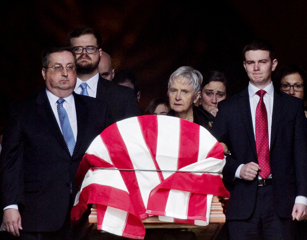 . Widow Maureen McCarthy Scalia, center, and other family members, walk behind the casket as it is ushered out of the Basilica following the funeral mass for the late Supreme Court Associate Justice Antonin Scalia, at the Basilica of the National Shrine of the Immaculate Conception in Washington, Saturday, Feb. 20, 2016. (AP Photo/Pablo Martinez Monsivais)