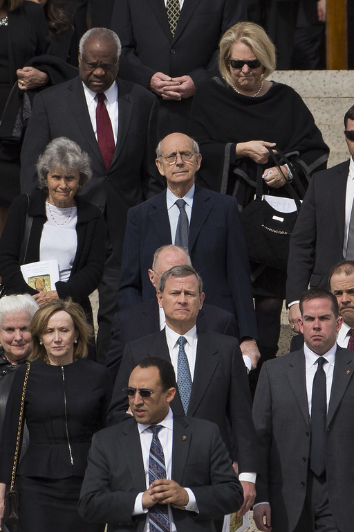 . WASHINGTON, DC - FEBRUARY 20: At center front, Supreme Court Chief Justice John Roberts and wife Jane Sullivan Roberts, trailed by former Justice Stephen Breyer and wife Joanna Hare and in back row, Justice Clarence Thomas and wife Virginia Thomas,  walk down the steps of the Basilica of the National Shrine of the Immaculate Conception at the end of the funeral for late Supreme Court justice Antonin Scalia, February 20, 2016 in Washington, DC. Scalia, who died February 13 while on a hunting trip in Texas, laid in repose in the Great Hall of the Supreme Court on Friday and his funeral service will be at the basilica today.  (Photo by Drew Angerer/Getty Images)