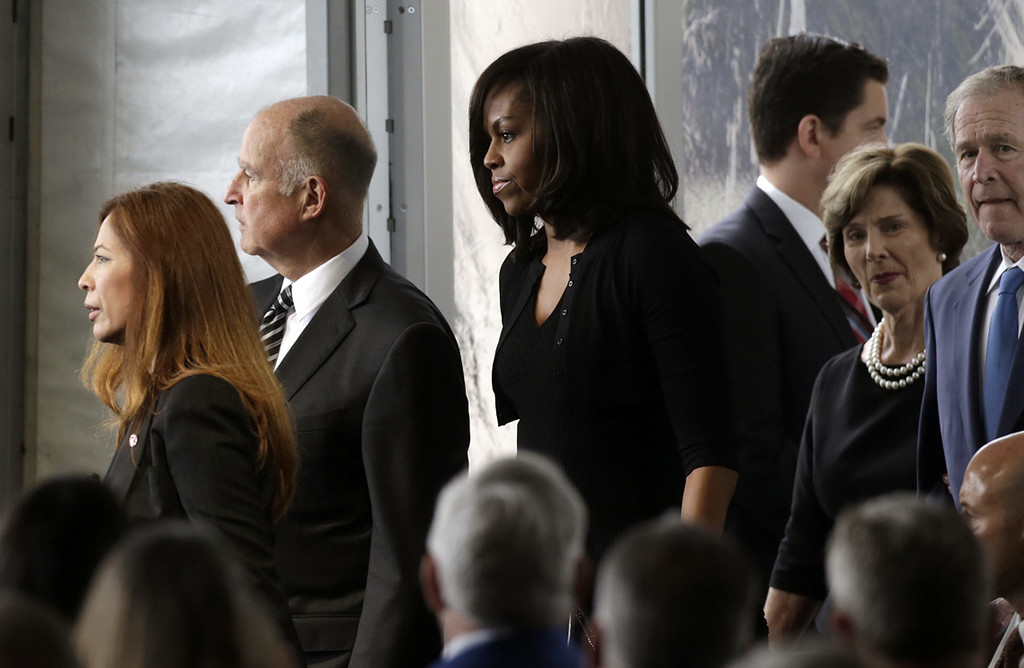 . First lady Michelle Obama, center, arrives with former President George Bush and his wife, Laura Bush, right, and Calif. Gov. Jerry Brown and his wife, Anne Gust, left,  for funeral services being held for former first lady Nancy Reagan at the Ronald Reagan Presidential Library March 11, 2016 in Simi Valley, California. Mrs. Reagan will be buried next to her husband on the property. (Photo by Irfan Khan-Pool/Getty Images)