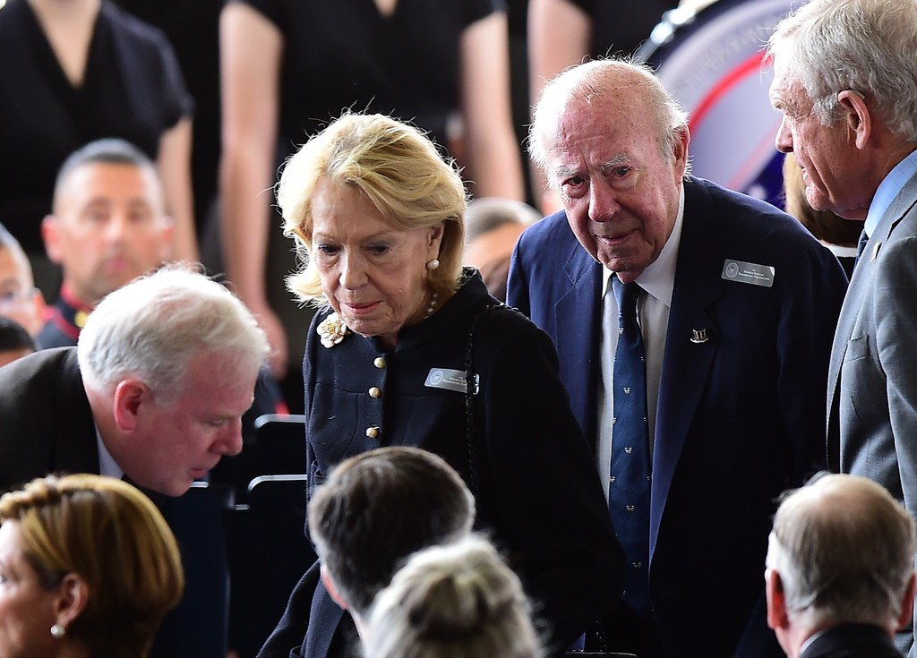 . Former US Secretary of State George Schultz (2nd R) and his wife, Charlotte Mailliard Shultz, arrive for funeral services for former First Lady Nancy Reagan at the Ronald Reagan Presidential Library on March 11, 2016, in Simi Valley, California.  AFP PHOTO/FREDERIC J.  BROWN/AFP/Getty Images