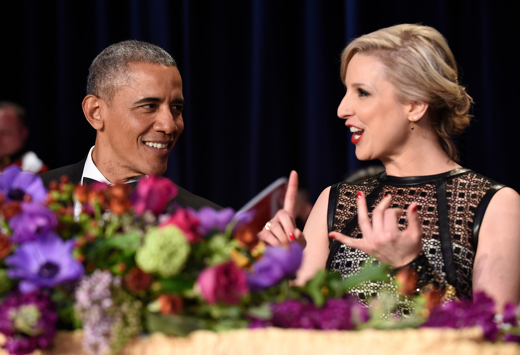 . President Barack Obama, left, talks with Carol Lee, right, of The Wall Street Journal, at the annual White House Correspondents\' Association dinner at the Washington Hilton in Washington, Saturday, April 30, 2016. (AP Photo/Susan Walsh)