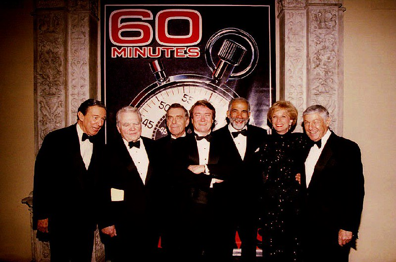 """. Members of television\'s \""""60 Minutes\"""" news program gather at the Metropolitan Museum of Art in New York, NY, 10 November 1993 to celebrate the 25th anniversary of the popular show. From left are: Mike Wallace, Andy Rooney, Morley Safer, Steve Kroft, Ed Bradley, Leslie Stahl, and Executive Producer Don Hewitt.  (Photo credit should read BOB STRONG/AFP/Getty Images)"""