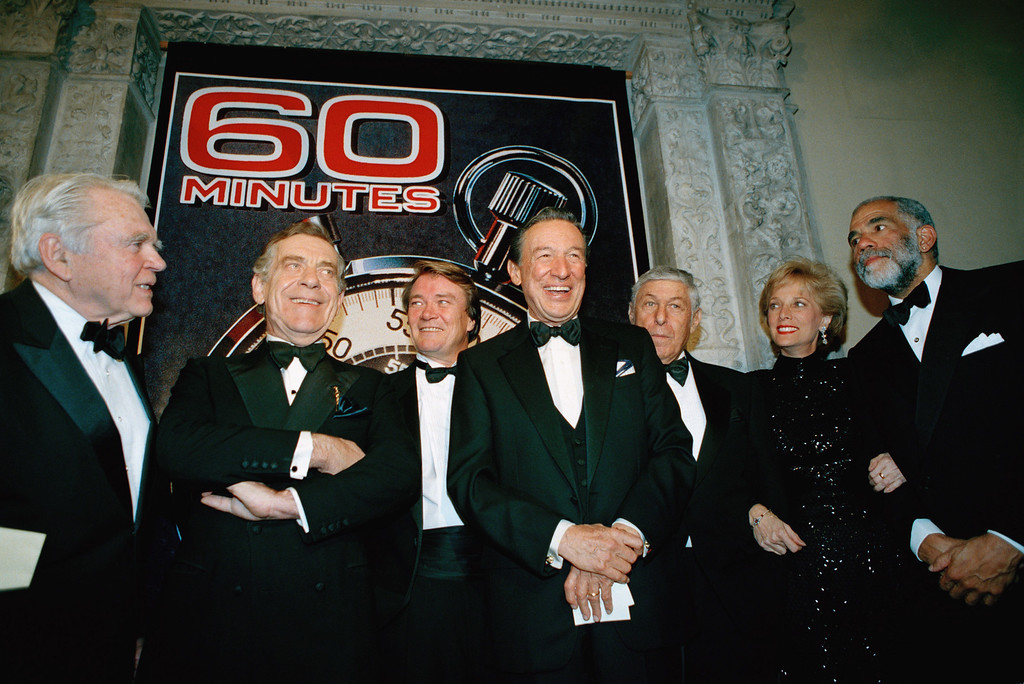 """. In this Nov. 10, 1993 file photo, the \""""60 Minutes\"""" team, from left,  Andy Rooney, Morley Safer, Steve Kroft, Mike Wallace, executive producer Don Hewitt, Lesley Stahl, and Ed Bradley pose for photographers at the Metropolitan Museum of Art in New York.  (AP Photo/Mark Lennihan, file)"""