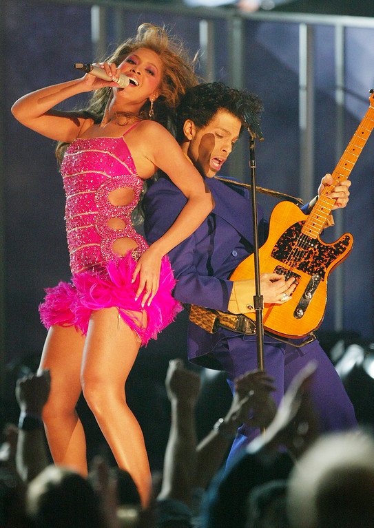 . Singer/actress Beyonce Knowles and Musician Prince perform at the 46th Annual Grammy Awards held at the Staples Center on February 8, 2004 in Los Angeles, California.  (Photo by Frank Micelotta/Getty Images)