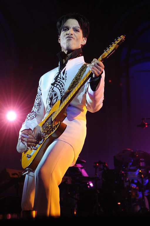 ". US singer Prince performs on October 11, 2009 at the Grand Palais in Paris. Prince has decided to give two extra concerts at the Grand Palais titled ""All Day/All Night\"" after he discovered the exhibition hall during Karl Lagerfeld\'s Chanel fashion show. (Photo by BERTRAND GUAY/AFP/Getty Images)"
